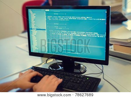 Developer Working On Source Codes On Computer At Office.