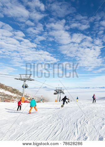 People Skiing And Ski Lift