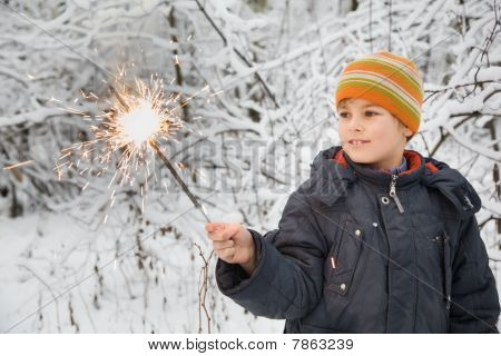 Cheerful Boy With Bengal Fire In Hand In Winter In Wood