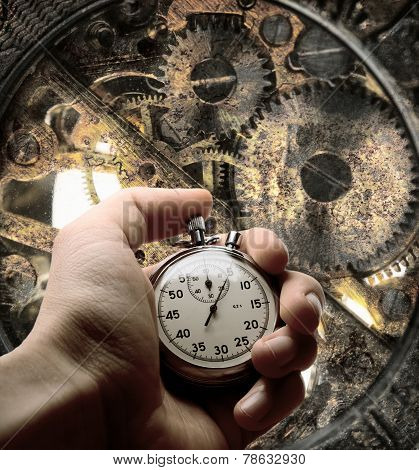 Hand With Stopwatch And Clockwork Inside