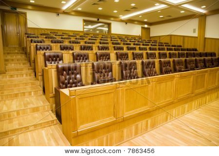 Conference Halls With Leather Armchairs And Wooden Tables