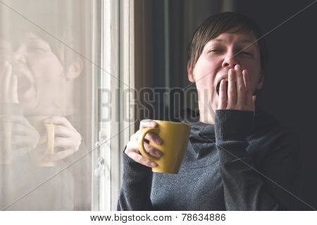 Beautiful Woman Drinking Coffee And Yawning
