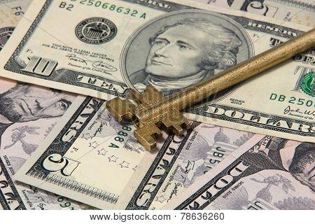 Yellow Key On Dollar Bills Closeup