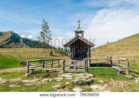 Wooden Chapel In The Alps