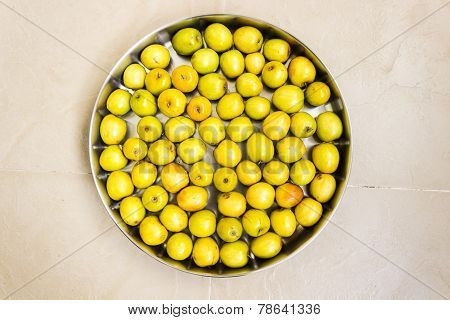 Indian jujube fruit arranged in a plate on a solid background