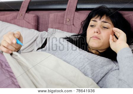 Woman In Bed Sad About Fever