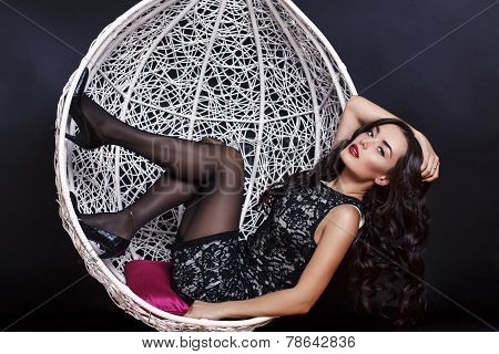 Beautiful Girl With Luxurious Dark Hair Wearing Lace Dress Posing At Studio
