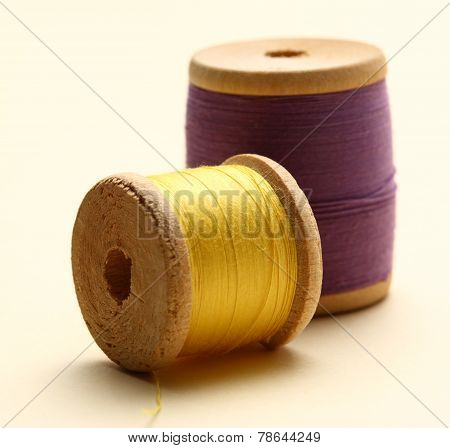 Thread Bobbins On White Background