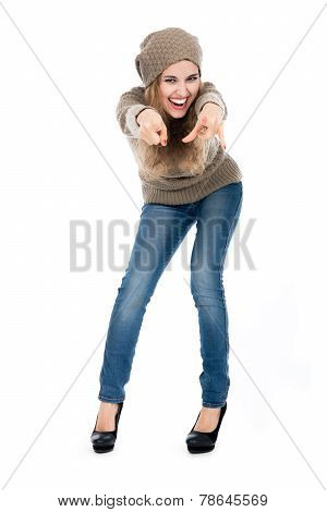 Young Woman In Sweater Pointing Finger At The Camera