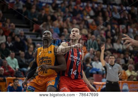 VALENCIA, SPAIN - DECEMBER 7:  (L) Sato (R) Tillie during Endesa Spanish League game between Valencia Basket Club and Laboral Kutxa Baskonia at Fonteta Stadium on December 7, 2014 in Valencia, Spain