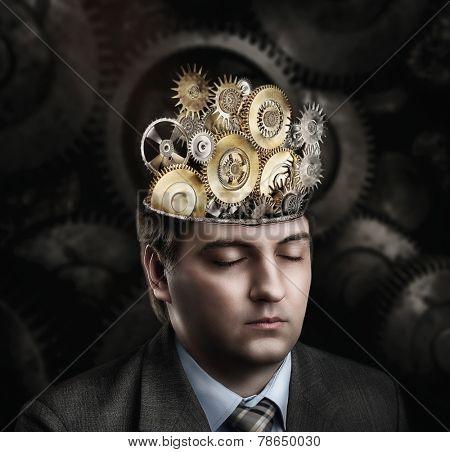 Man with cogwheel mechanism