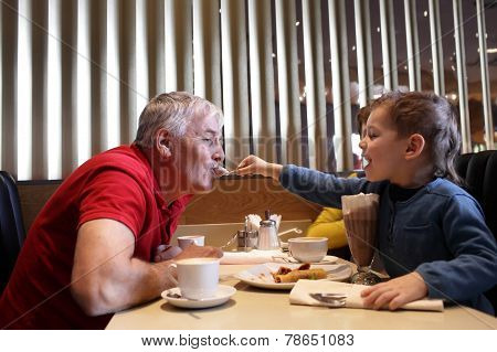 Grandchild Feeds His Grandfather