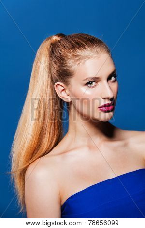 Beauty portrait of gorgeous woman with ponytail