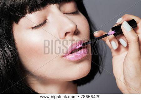 Professional Make-up. Pink lipgloss. Lipstick