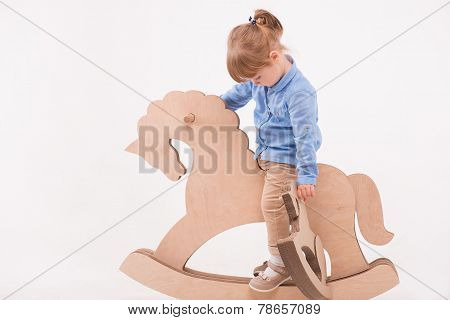 Child with the toy horse
