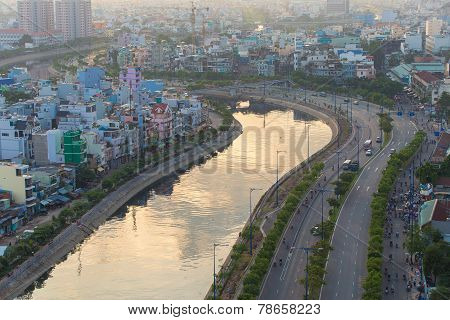 curve of Ho Chi Minh Riverside cityscape night view with Ben Nghe or Tau Hu canal and calmet Bridge