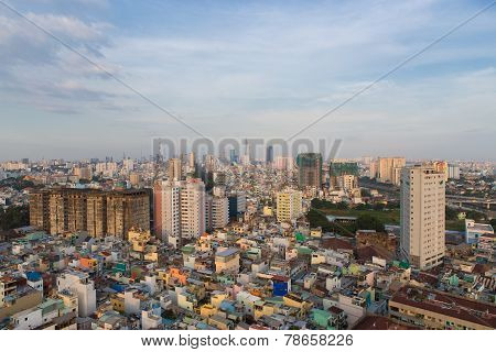 Ho Chi Minh City / Vietnam - Dec 14 2014: Poor Houses In Ho Chi Minh Riverside Cityscape View With B