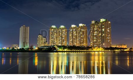 Deluxe apartment under night viewed from Thu Thiem peninsula in Ho chi minh city, Vietnam