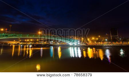 one hundred years old green Mong bridge at Tau Hu canal at night view at Ho Chi Minh City ( Saigon )