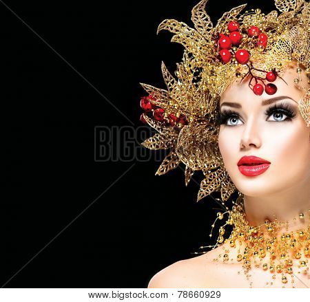 Christmas Winter Fashion Model Girl with golden hairstyle and make up. Beauty Woman. Beautiful New Year Holiday Creative Hair style decorated with Baubles. Lady face isolated on black Background