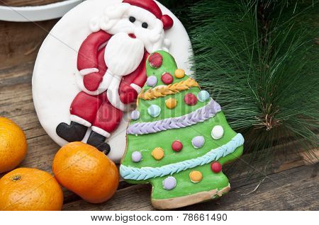 gingerbread cookie with mandarins on an old wooden Christmas background
