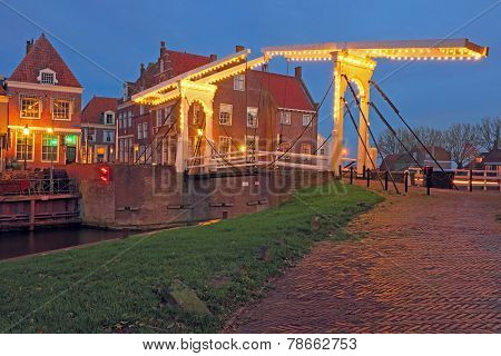 Medieval bridge agnd houses in Enkhuizen the Netherlands at night