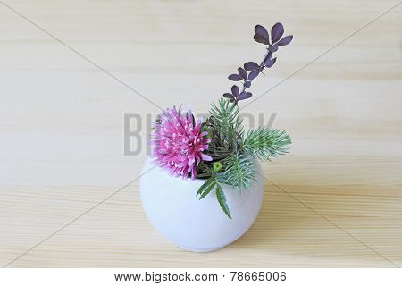 Ikebana With Pink Flower, Branch, Blue Spruce And Barberry In A White Vase