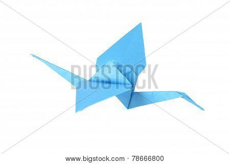 Blue origami crane isolated over white background