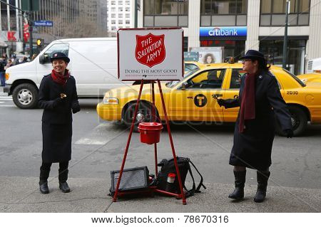 Salvation Army soldier performs for collections