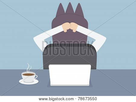 Businessman Relaxing In The Office At His Desk