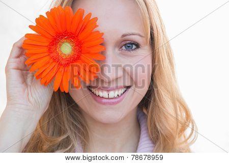 beautiful woman holding orange marguerite