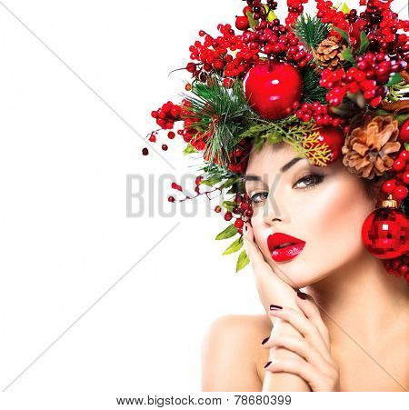 Christmas fashion model woman. Xmas New Year hairstyle and make up. Beauty Girl portrait. Gorgeous Vogue style Lady with Christmas decorations on her head, baubles, professional makeup, red lipstick