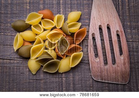 Delicious Pasta On Wooden Texture. Wooden Fork.