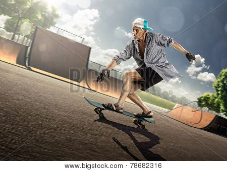 The old man is skating on skateboard