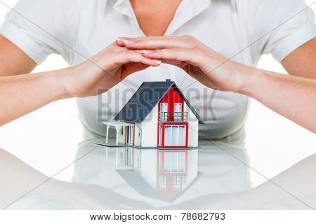 a woman protecting your home and home. good and reputable insurance financing calm.