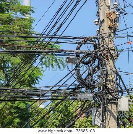 Messy Electric Cables On Pole In Bangkok, Thailand