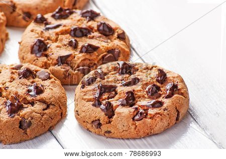 Chocolate cookies close up on white wood background