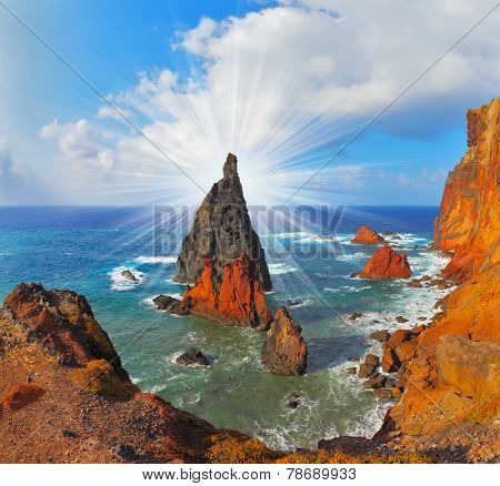 Atlantic storms. Colorful pinnacles lit sunset. Arid eastern tip of the island of Madeira