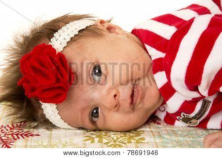 Cute Newborn Girl Laying Down With Flower Headband