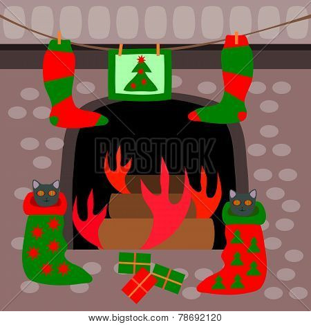 Kittens waiting for gifts in socks front of a fireplace