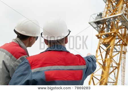 Two Builders At Construction Site