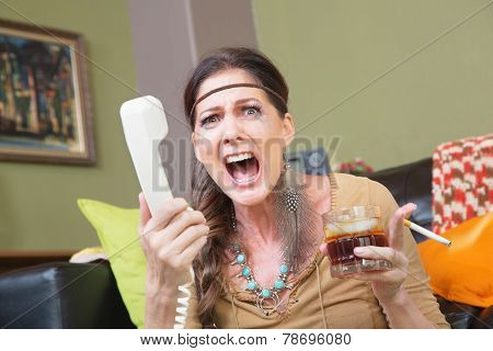 Upset Woman Yelling Into Phone