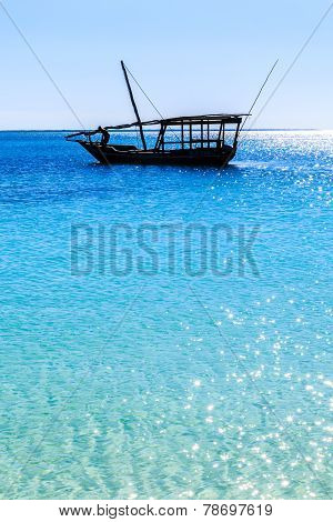 Traditional Fisherman Boat Lying Near The Beach