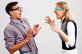 foto of stereotype  - Nerdy woman is shouting at her boyfriend. ** Note: Soft Focus at 100%, best at smaller sizes - JPG