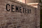 foto of graveyard  - The word cemetery on a brick wall at the entrance of a graveyard - JPG