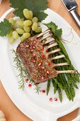 foto of crust  - Herb crusted rack of lamb garnished with asparagus green grapes and pomegranates - JPG