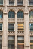 picture of scrollwork  - An old stone building in Chicago with detailed scrollwork on arched windows - JPG
