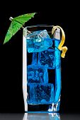 stock photo of curacao  - Blue curacao cocktail with decoration in closeup - JPG