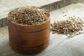 pic of flax seed oil  - Flax seeds in bowl on wooden background - JPG