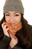 stock photo of beanie hat  - Brunette teen model snuggling hat and beanie - JPG